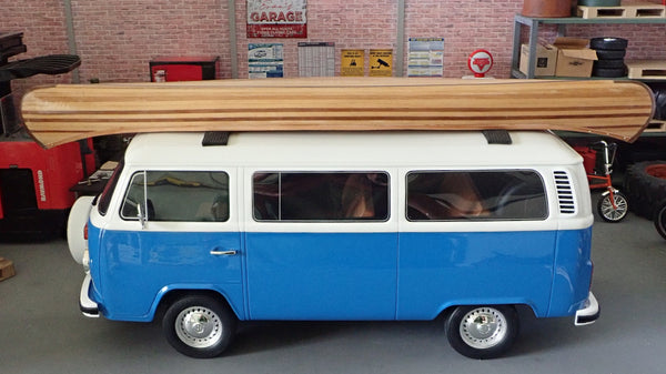 A scale model VW bus with a wooden canoe on top of it