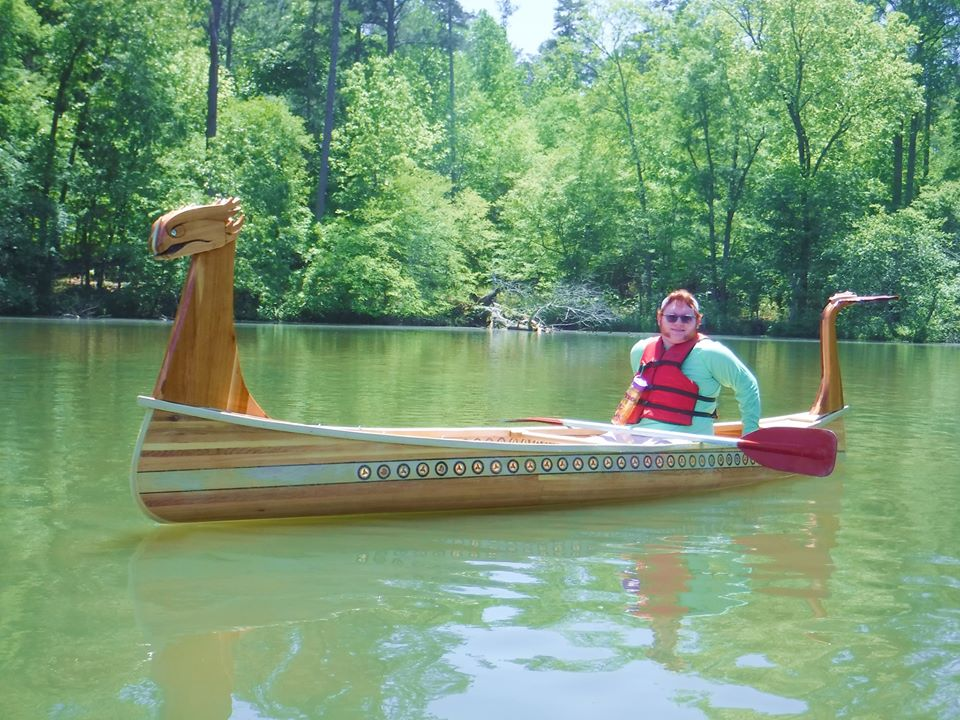 Dragon Canoe by Frank Turner on the water