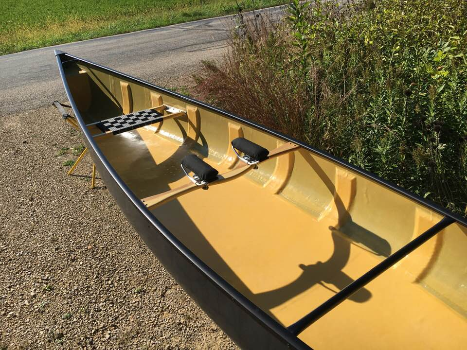Finished composite canoe by Randy Pfeifer laying right side up in a driveway