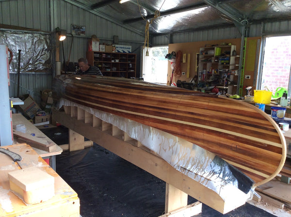 Champlain canoe with exterior fibreglassed and ready to be removed from molds