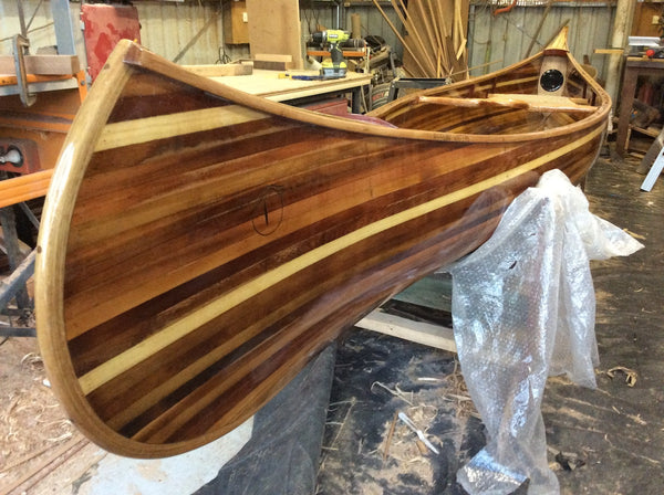 Champlain wooden canoe, now off the molds and turned over in its cradle