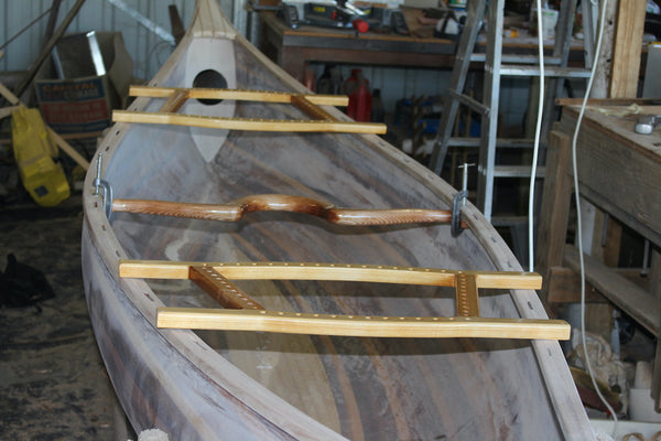 Champlain canoe with yoke and trim laid out in preparation for installation