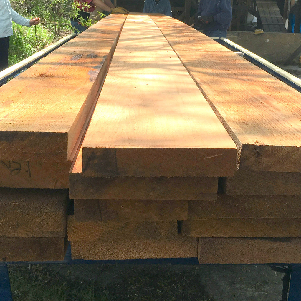 A pile of lumber to be milled into strips for canoes or kayaks