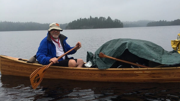 Ron Frenette paddles a wooden canoe on a trip to the Kipawa
