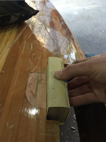 Sanding hull smooth to accommodate patch