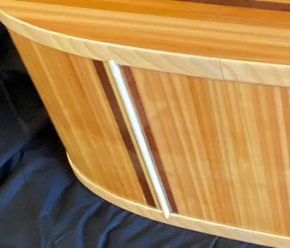 Strip of wood to prevent wannigan from rocking, after wood has been finished