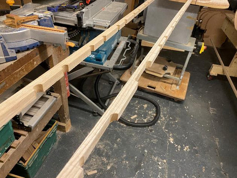 Scuppered gunwales laid out in a woodshop