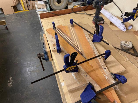 Canoe deck clamped into a jig