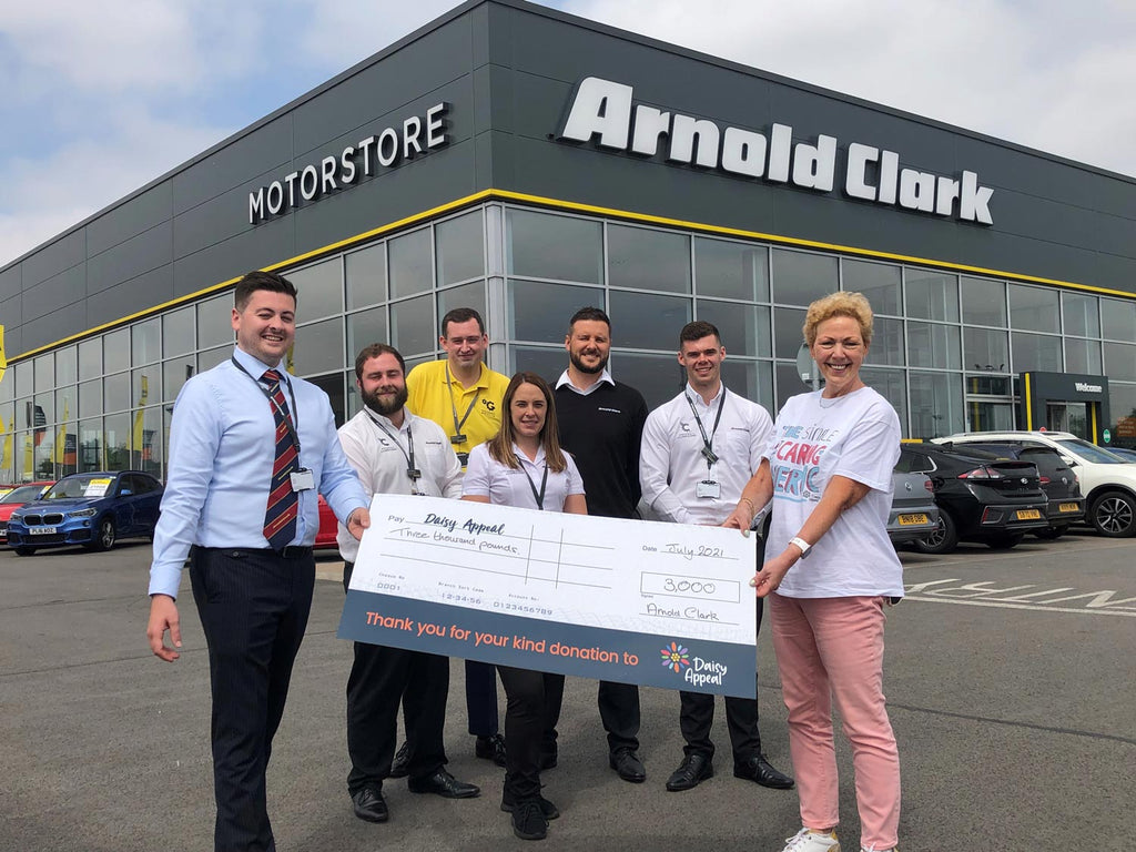 Claire Levy is pictured receiving a cheque for £3,000 from George Ferebee of Arnold Clark's York Motorstore.