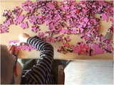 child plays with Arbracadabra Puzzle brightly colored floral animal  puzzle