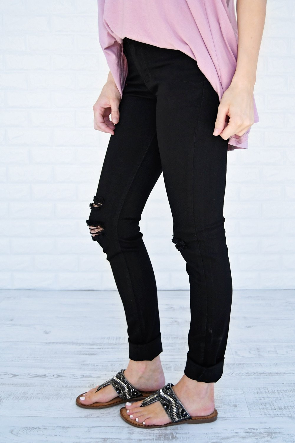 The Ultimate Black Distressed Skinnies