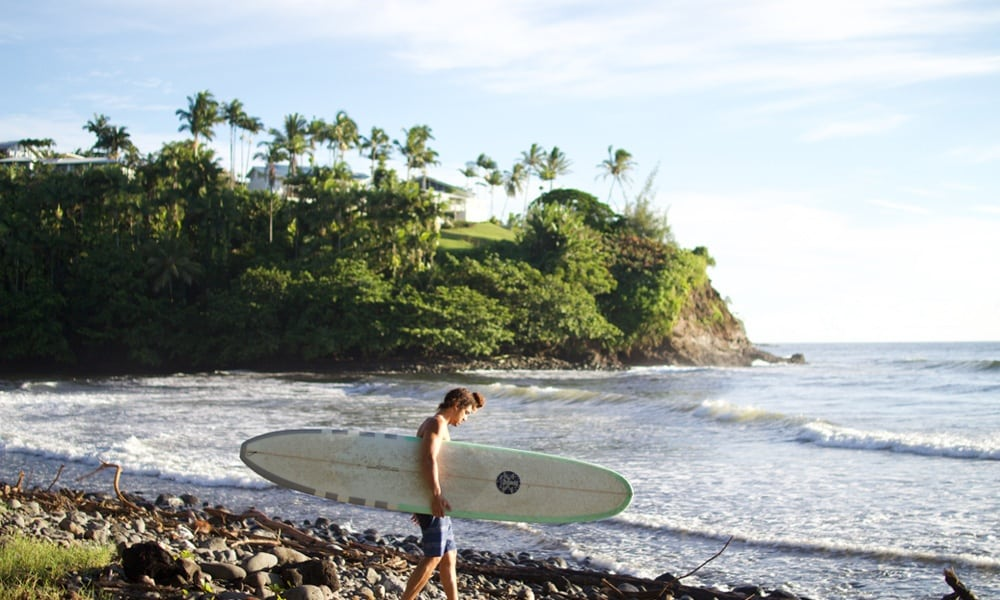 Man heading out to surf