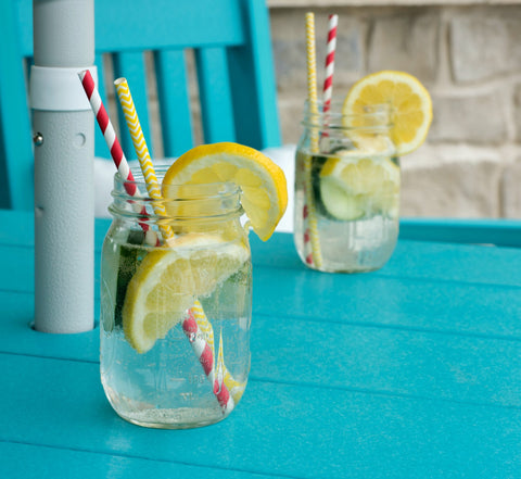 Cucumber Lemon Water in with straws in Mason jars
