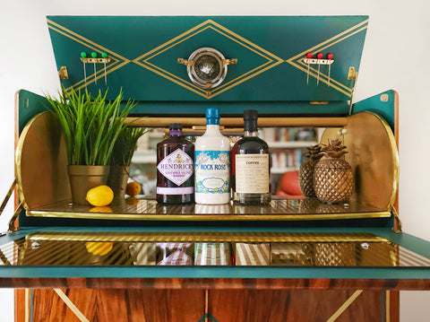 Art Deco inspired drinks cabinet showing a range of gins