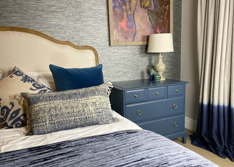 Photo of stylish bedroom featuring a set of Stag drawers in blue