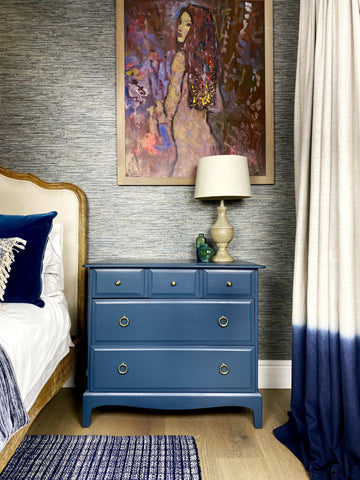 Stag Minstrel Chest of drawers in seaside blue in a beautiful bedroom