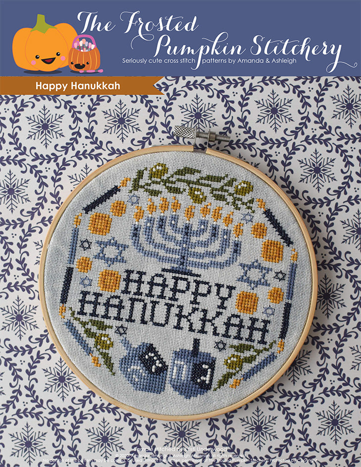 "Happy Hanukkah counted cross stitch pattern. Image of a menorah surrounded by the words ""Happy Hanukkah,"" candles, multiple Star of David, gelt, dreidels and olive branches."