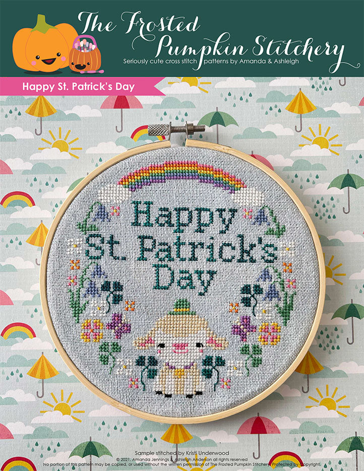 Happy St. Patrick's Day cross stitch pattern features a little lamb with a hat surrounded by spring wildflowers and a rainbow.