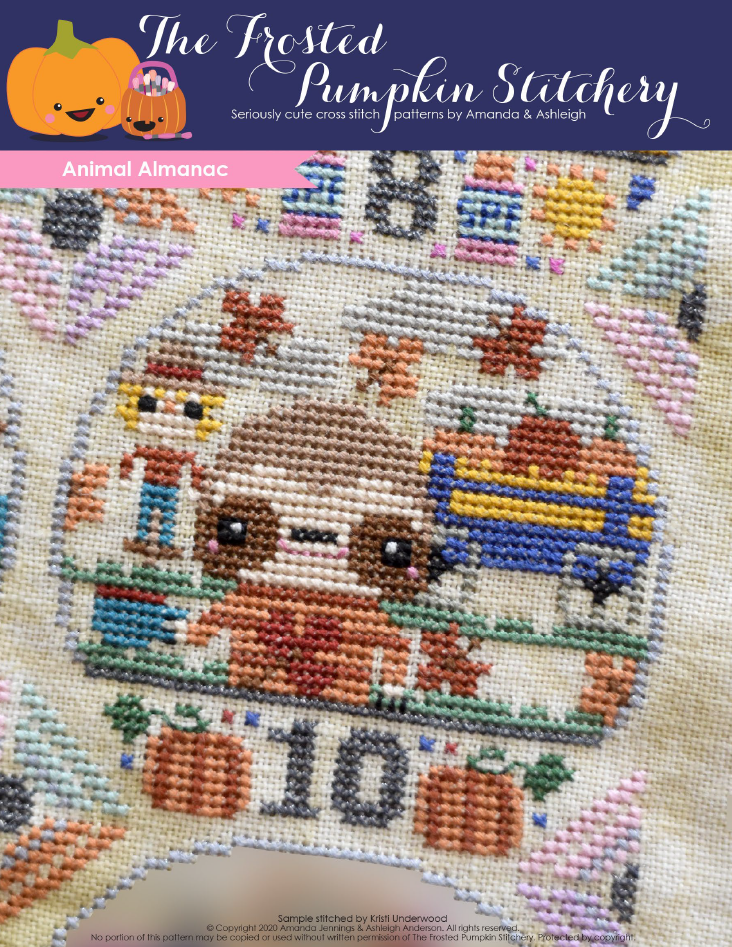 Animal Almanac Cross Stitch Pattern Cover. Image of sloth wearing an autumn sweater and drinking a coffee while spending time at the local pumpkin patch. A scarecrow, wagon full of hay and autumn leaves are in the background.