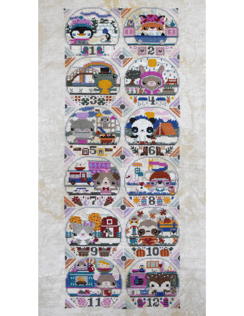Animal Almanac Cross Stitch Pattern Cover. Includes penguin, fox, frog, rabbit, hippo, panda and dog.