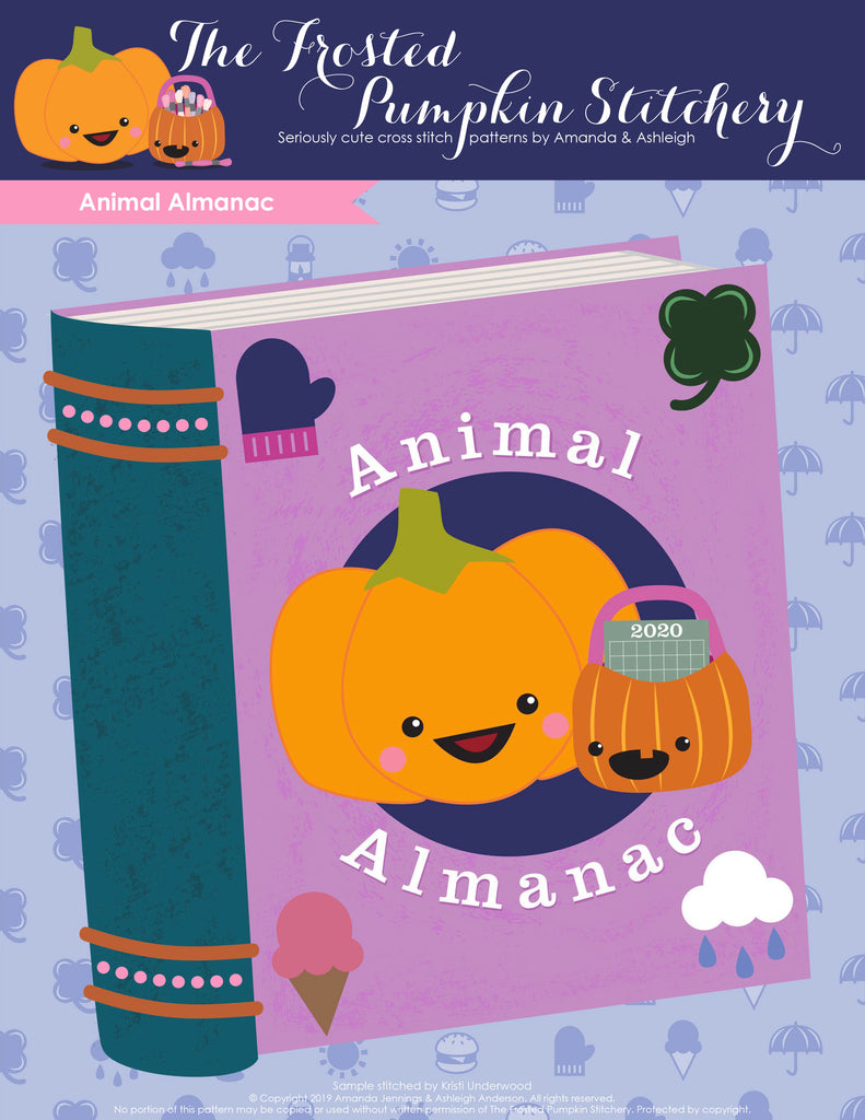 Animal Almanac Cross Stitch Pattern Cover. Image of Jack and Sugarloaf, The Frosted Pumpkin Stitchery's two mascots are on the cover of a purple book.