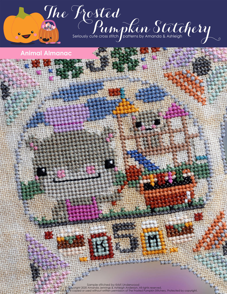 Animal Almanac Cross Stitch Pattern Cover. Image of a hippo wearing an apron and chef's hat grilling. He's standing next to a grill. A baby hippo plays behind him.