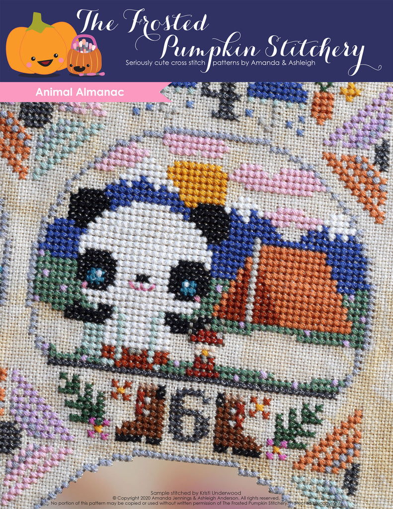 Animal Almanac Cross Stitch Pattern Cover. Image of a panda bear wearing suspenders and pants. He's holding a camping lantern and is in the mountains with a tent.