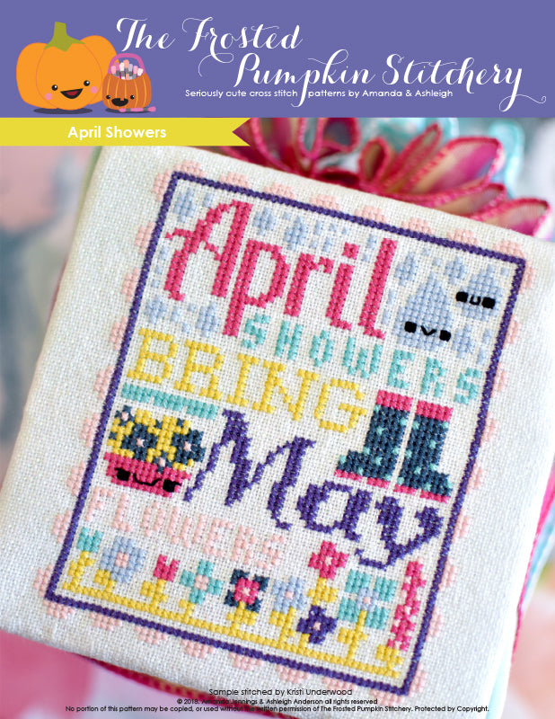 Image of April Showers counted cross stitch pattern. Text reads April Showers Bring May Flowers.