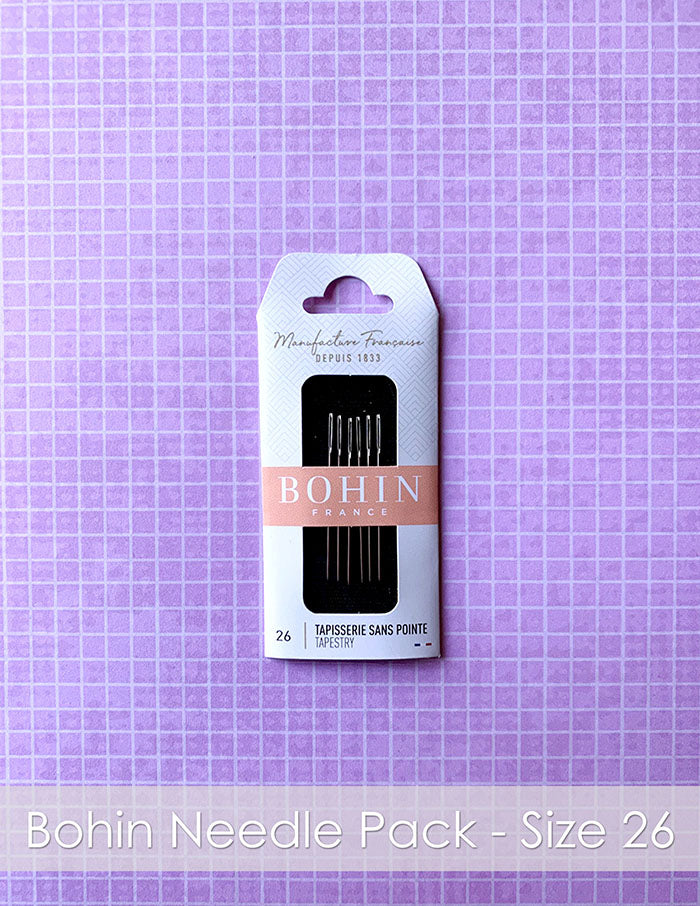 Bohin France Needle Pack Size 26. A package of tapestry needles on a pink plaid background