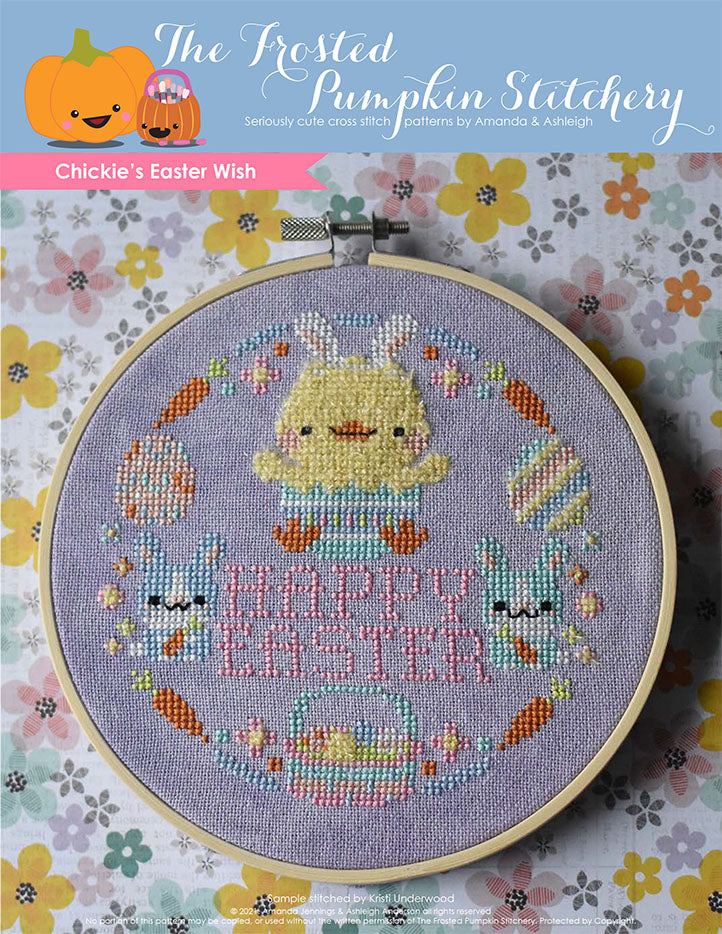 "Chickie's Easter Wish Cross Stitch Pattern. This pattern is finished in a 6"" embroidery hoop and features a fuzzy chick hatching from an Easter egg surrounded by pastel bunnies, carrots, flowers, eggs, Easter basket and the phrase ""Happy Easter."""