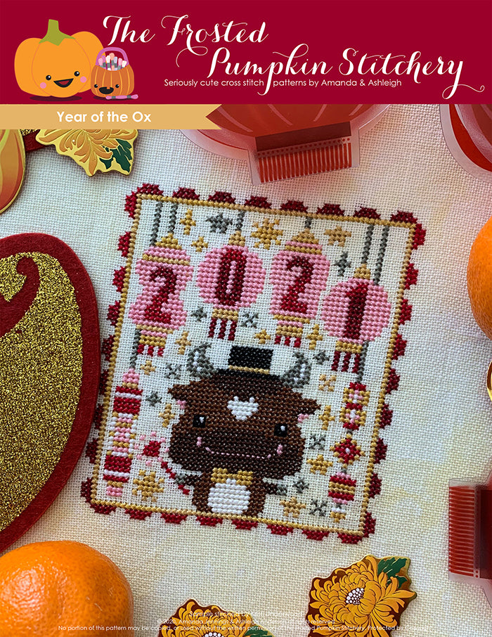 Chinese Zodiac Year of the Ox counted cross stitch pattern. An ox wearing a top hat and holding a sparkler under lanterns with the numbers 2021