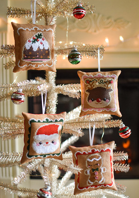 Cookies for Santa counted cross stitch pattern. Chubby ornaments are hanging on a tinsel tree.