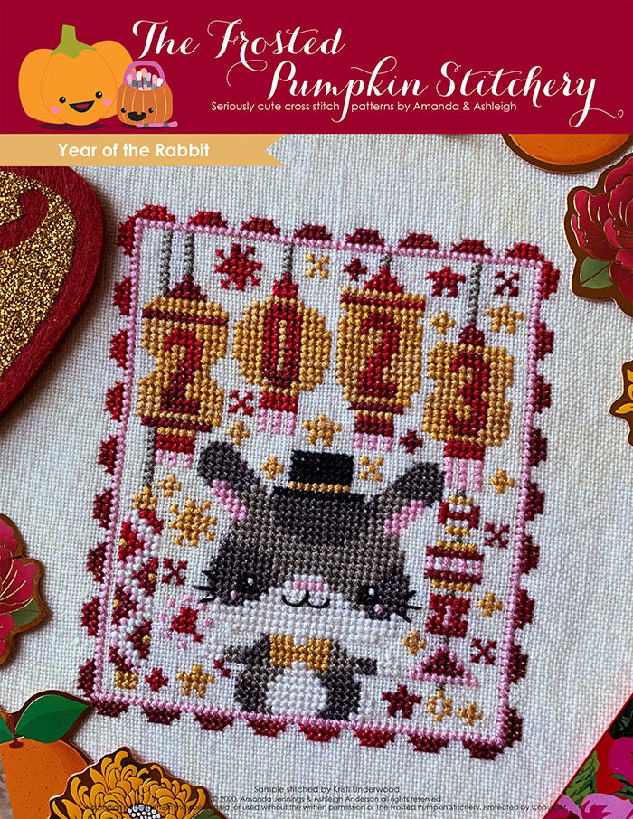 Year of the Rabbit Chinese zodiac counted cross stitch pattern features customizable year lanterns, a rabbit and a color palette of red and gold.