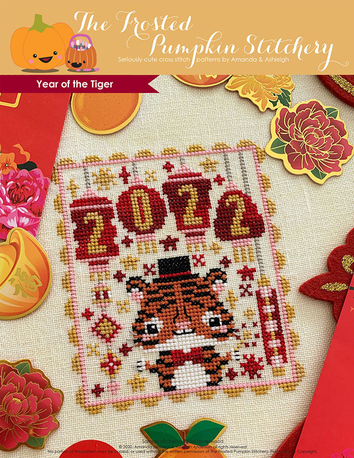 Year of the Tiger counted cross stitch pattern. A tiger wearing a top hat and sparkler with lanterns that say 2022.
