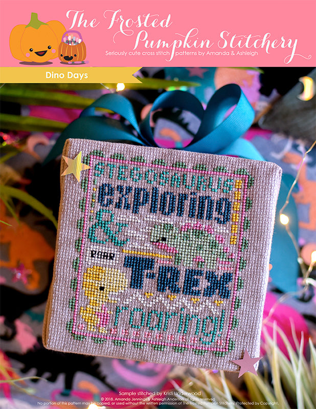"Dino Days counted cross stitch pattern. Text reads ""Stegosaurus Exploring and T-Rex Roaring""."