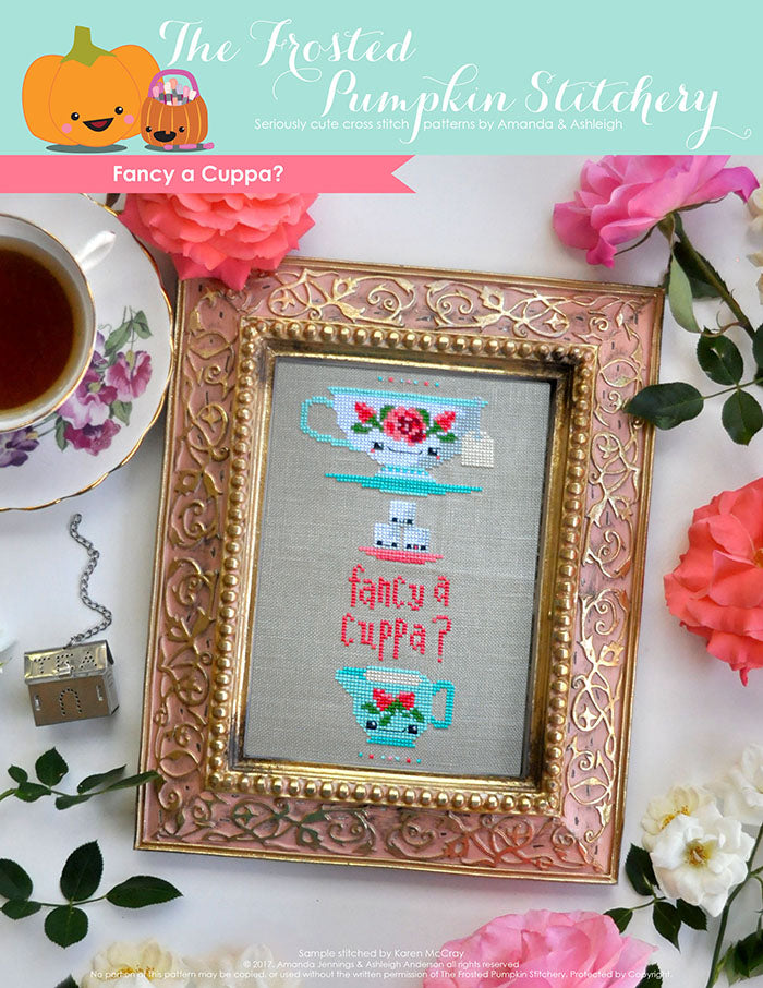 "Fancy a Cuppa counted cross stitch pattern. A traditional tea cup with roses, stacked on top of sugar cubes with text that reads ""fancy a cuppa""."