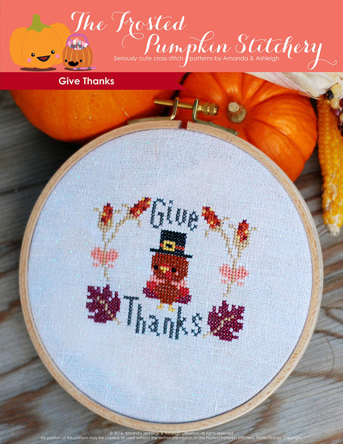 "Give Thanks counted cross stitch pattern. A little Thanksgiving turkey wearing a hat surrounded by leaves and the text says ""Give Thanks""."