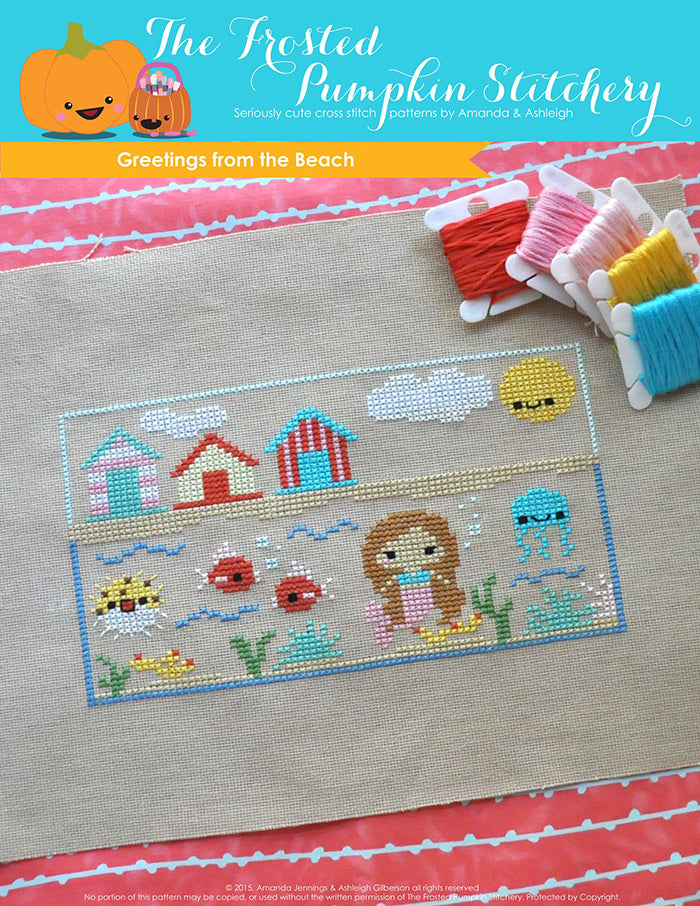 Greetings from the Beach summer mermaid counted cross stitch pattern. A cross stitch pattern of a postcard with a mermaid and beach houses.
