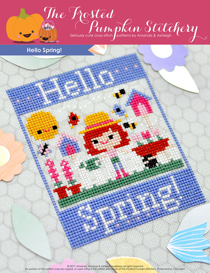 "Hello Spring counted cross stitch pattern. A white girl with red hair is gardening. Text reads ""Hello Spring""."