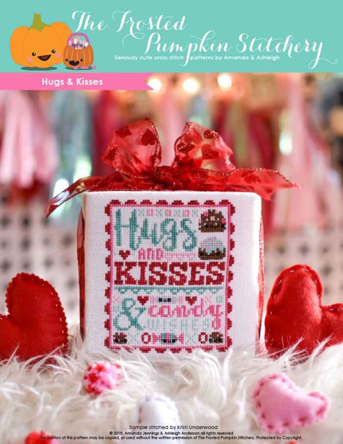 "Hugs and Kisses counted cross stitch pattern. Text reads ""Hugs and Kisses and Candy Wishes""."
