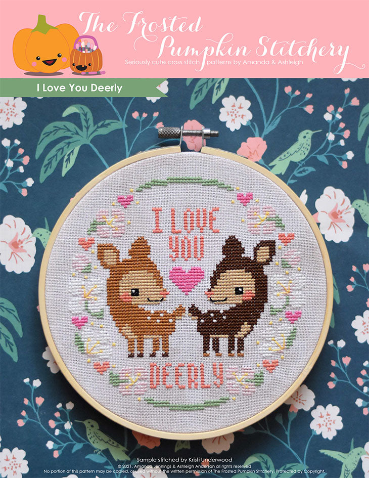 "I Love You Deerly Cross Stitch Pattern. This pattern is finished in a 6"" embroidery hoop and features two deer standing amongst spring blossoms,  hearts and the phrase, ""I Love You Deerly."""