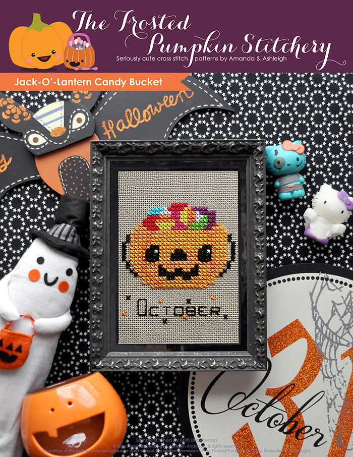Jack'-O-Lantern Candy Bucket counted cross stitch pattern. A candy bucket filled with candy in a black frame.cross stitch pattern