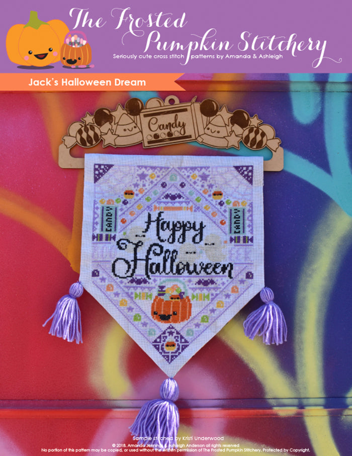 "Jacks Halloween Dream counted cross stitch pattern. A hanging banner on a graffiti background. Text reads ""Happy Halloween""."