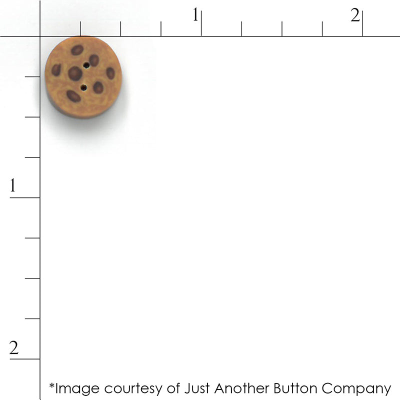 Just Another Button Company chocolate chip cookie button with a ruler for scale.