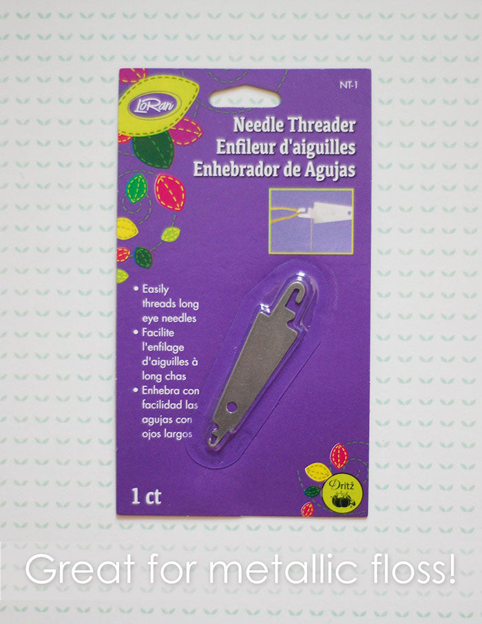 "LoRan needle threader. A metal needle threader in a purple package. Text reads ""Great for metallic floss""."