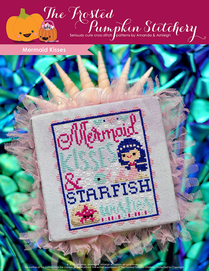"Mermaid kisses counted cross stitch pattern. Text reads ""Mermaid kisses and starfish wishes"". A white skinned blue haired mermaid swims under the sea with a starfish."