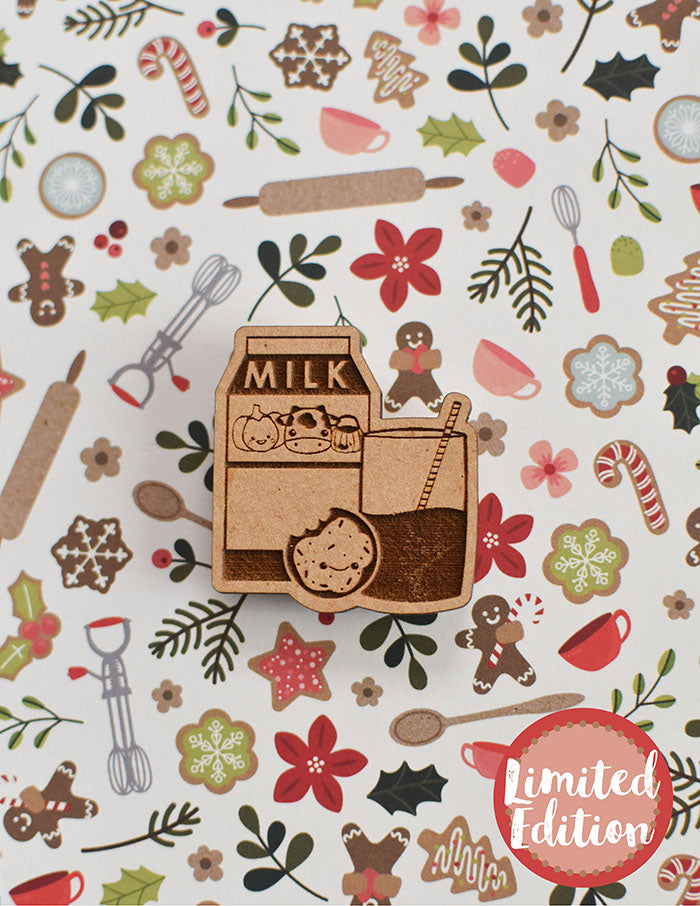 Image of a wooden needleminder with a carton of milk with a cow, a cookie and a glass of milk.