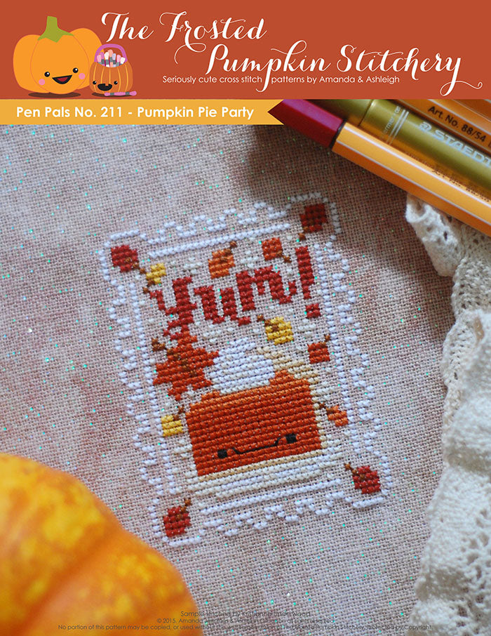 "Pen Pals No 211 Pumpkin Pie Party counted cross stitch pattern. A kawaii slice of pumpkin pie on a plate. Surrounded by falling leaves and the word ""Yum""."