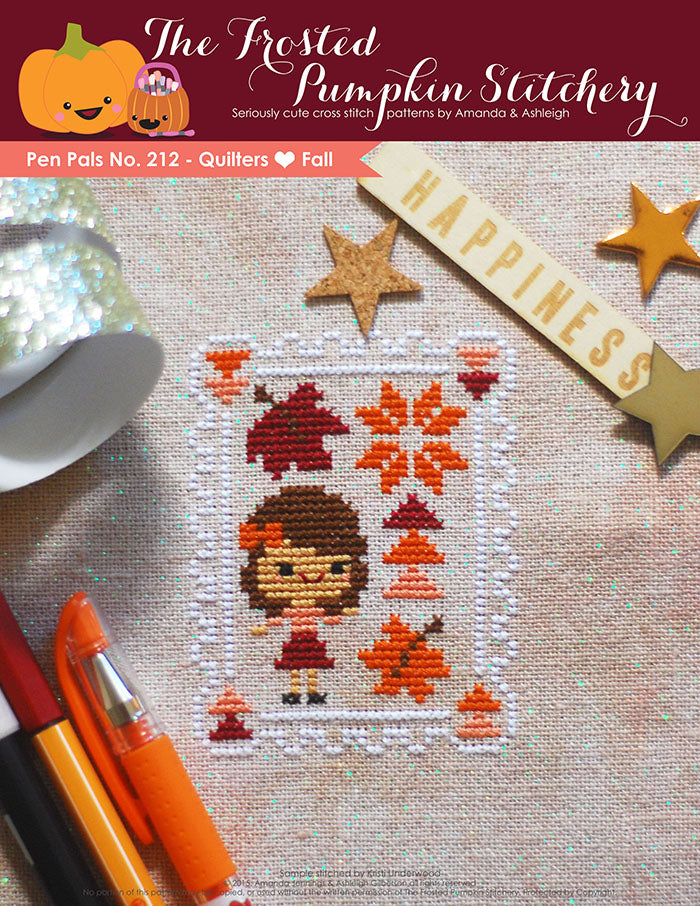 Pen Pals No 212 Quilters Love Fall counted cross stitch pattern. A fair skinned girl with brown hair and an orange bow stands next to quilt blocks.