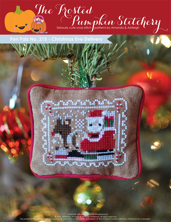 Pen Pals No 215 Christmas Eve Delivery counted cross stitch pattern. Santa and Rudolph fly over a village on Christmas Eve.